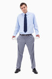 Broke businessman showing his empty pockets Royalty Free Stock Photos