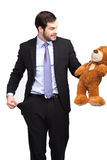 Broke businessman with teddy bear Stock Photo