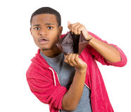 Broke guy with empty wallet Stock Photography