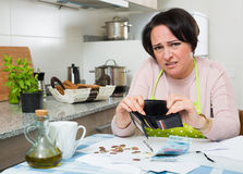 Broke housewife without money enough for payment Stock Photos