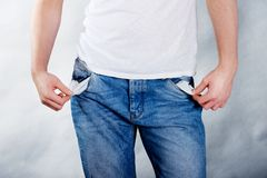 Broke man with empty pockets. Royalty Free Stock Image