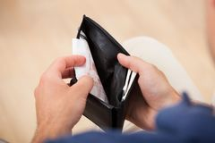 Broke Man Holding Wallet Stock Image