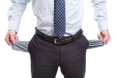 Broke and poor business man with empty pockets stock photo