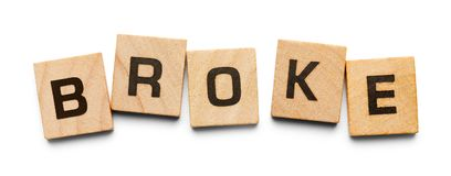 Broke Wood Tiles. Broke Spelled with Wood Tiles Isolated on a White Background royalty free stock images