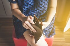 Broke woman hand holding Empty wallet,Concept having cost control expenses,No money. Broke woman hands holding Empty wallet,Concept having cost control expenses stock images