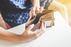 Broke woman hand holding Empty wallet,Concept having cost control expenses,No money. Broke woman hands holding Empty wallet,Concept having cost control expenses royalty free stock photography