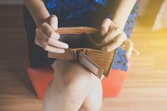 Broke woman hand holding Empty wallet,Concept having cost control expenses,No money. Broke woman hands holding Empty wallet,Concept having cost control expenses stock photos