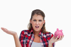Broke woman holding a piggy bank Stock Photo