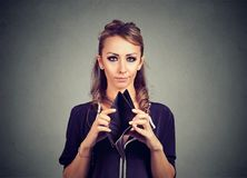 Broke young woman with no money and empty wallet. Broke woman with no money and empty wallet royalty free stock images