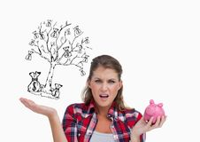 Broke woman with piggy-bank and money tree draw in the other hand . empty pocket concept. White back. Digital composite of Broke woman with piggy-bank and money Royalty Free Stock Image