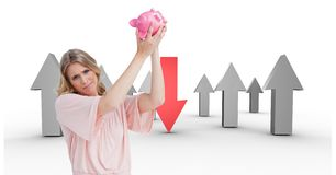 Broke woman with piggy-bank trying get money. empty pocket concept. arrows on back Stock Image