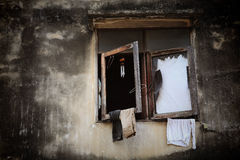 Broke wooden windows with hanging cloths Royalty Free Stock Photos
