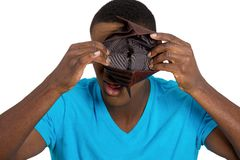 Broke young man showing empty wallet Stock Image
