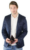 Broke young man showing empty wallet Royalty Free Stock Photo