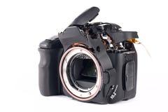 Broked DSLR camera. Broken and disassembled DSLR photocamera Royalty Free Stock Photo
