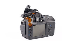 Broked DSLR camera. Broken and disassembled DSLR photocamera Royalty Free Stock Photos