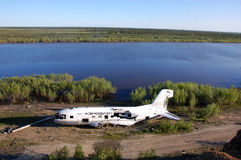 Broken abandoned airplane at Kolyma river coast Royalty Free Stock Photos