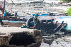 Broken abandoned fishing boat by the shore Stock Images