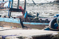 Broken abandoned fishing boat by the shore Stock Photography