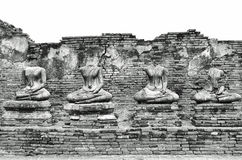 Broken Ancient Buddha Statues Ruins at Wat Chaiwatthanaram in The Historic City of Ayutthaya, Thailand in Classic Vintage Black an. Ancient Buddha Statues Ruins Royalty Free Stock Photo