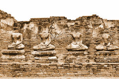 Broken Ancient Buddha Statues Ruins at Wat Chaiwatthanaram in The Historic City of Ayutthaya, Thailand in Vintage Sepia Color Royalty Free Stock Image