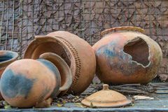 Broken antique clay pot or traditional Jar on abandoned hut Royalty Free Stock Photo