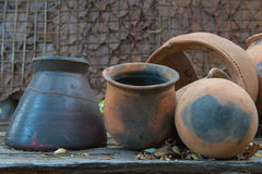 Broken antique clay pot or traditional Jar on abandoned hut Royalty Free Stock Image