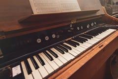 Broken antique piano Stock Image