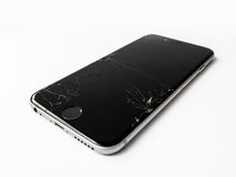 Broken Apple iPhone 6 with cracked screen. CHIANGRAI, THAILAND -SEPTEMBER 18, 2016: Close up image of broken Apple iPhone 6 with cracked screen isolate on white stock image
