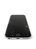 Broken Apple iPhone 6 with cracked screen. CHIANGRAI, THAILAND -SEPTEMBER 18, 2016: Close up image of broken Apple iPhone 6 with cracked screen isolate on white stock images
