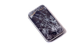 Broken Apple iphone. Broken iPhone with smashed glass screen on white background. Photo taken on: August 28nd, 2011 royalty free stock photography