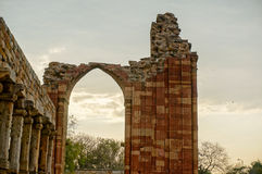 Broken arch at Qutub Minar. Broen arch at the qutub minar framing a clouded sky. Highlights the need to preserve our national monuments Stock Photography