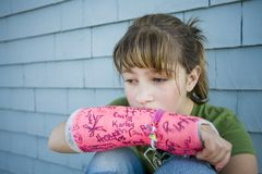 Broken Arm. Photo of Maggie in a pink cast Stock Photography