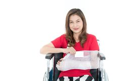 Broken arm Asian woman with arm sling sponsored in her hands sit royalty free stock image