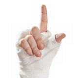 Broken arm in a cast. Finger pointing up Royalty Free Stock Photos
