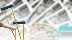 Broken arm, closeup woman arm with splint and holding wooden crutches on blurred background Japanese currency yen bank. Notes, coin and calculator, health care royalty free stock photography