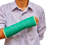 Broken arm with green cast on white background Stock Image
