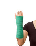 Broken arm with green cast on white background Royalty Free Stock Photography