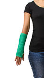 Broken arm with green cast on white background Stock Photos