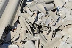 Broken asbestos roof. Peaces on heap Royalty Free Stock Images