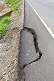 Broken asphalt. Royalty Free Stock Photo