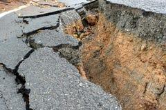 Broken asphalt road Stock Images