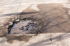 Broken asphalt on the road. Broken asphalt and pot hole on the road dangerous to motorists royalty free stock photos
