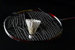 Broken badminton strings. Broken badminton racket is shown here along with one feather shuttle Broken badminton racket is shown here along with one feather Stock Photos