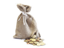 Broken bag of money Royalty Free Stock Image
