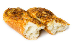 Broken baguette with cheese and garlic Royalty Free Stock Images