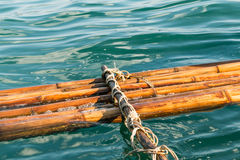 Broken bamboo raft float on the water Stock Image