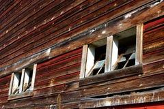 Broken Barn Windows. Cracked windows on an old barn royalty free stock image