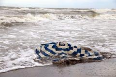 Broken beach umbrella in the sea Royalty Free Stock Image