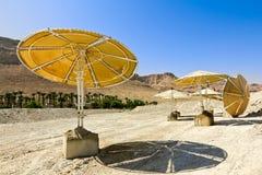 Broken beach umbrellas at the dead sea in Israel Royalty Free Stock Photo